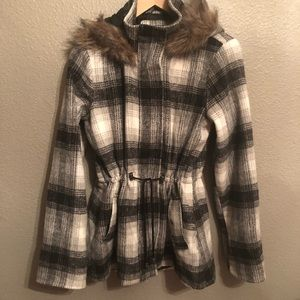Black/white/grey plaid jacket with fur hoodie.